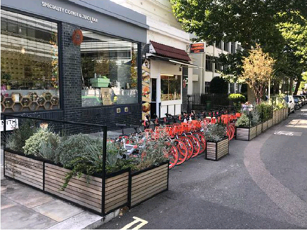 An image showing a high street planter with bike parking
